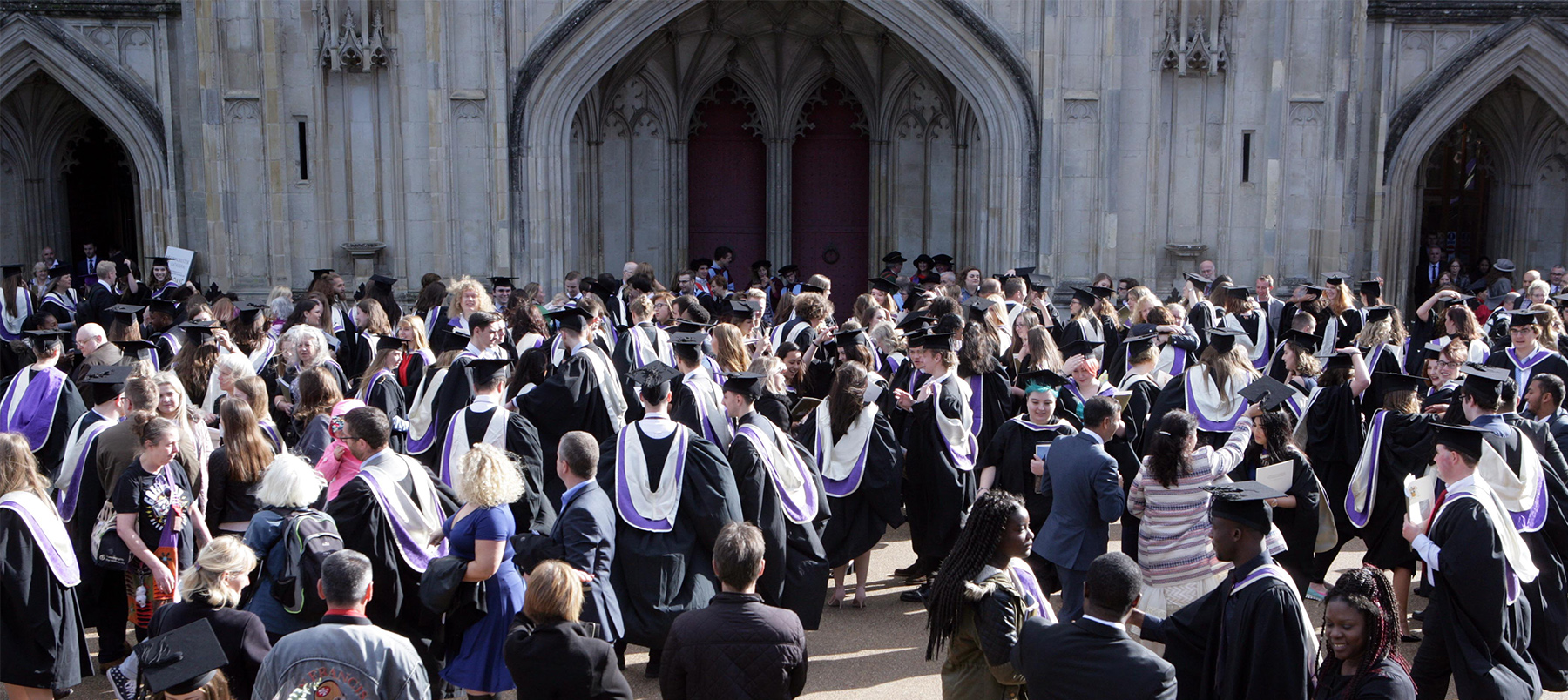 Crowd of graduates and families outside of Cathedral on Graduation