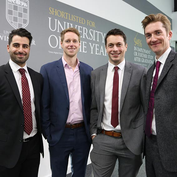 Four male members of the HELP Hampshire team at the launch event