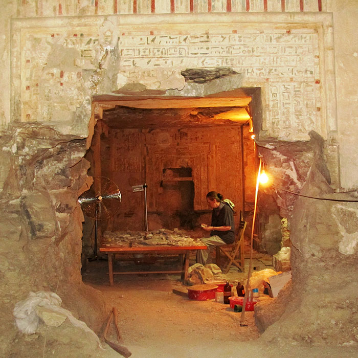 A lady doing research in ancient Egyptian building
