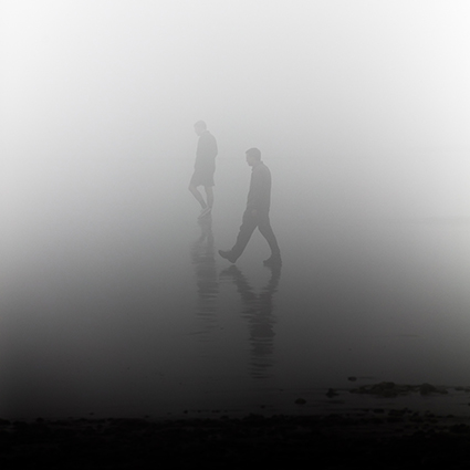 People walking in mist