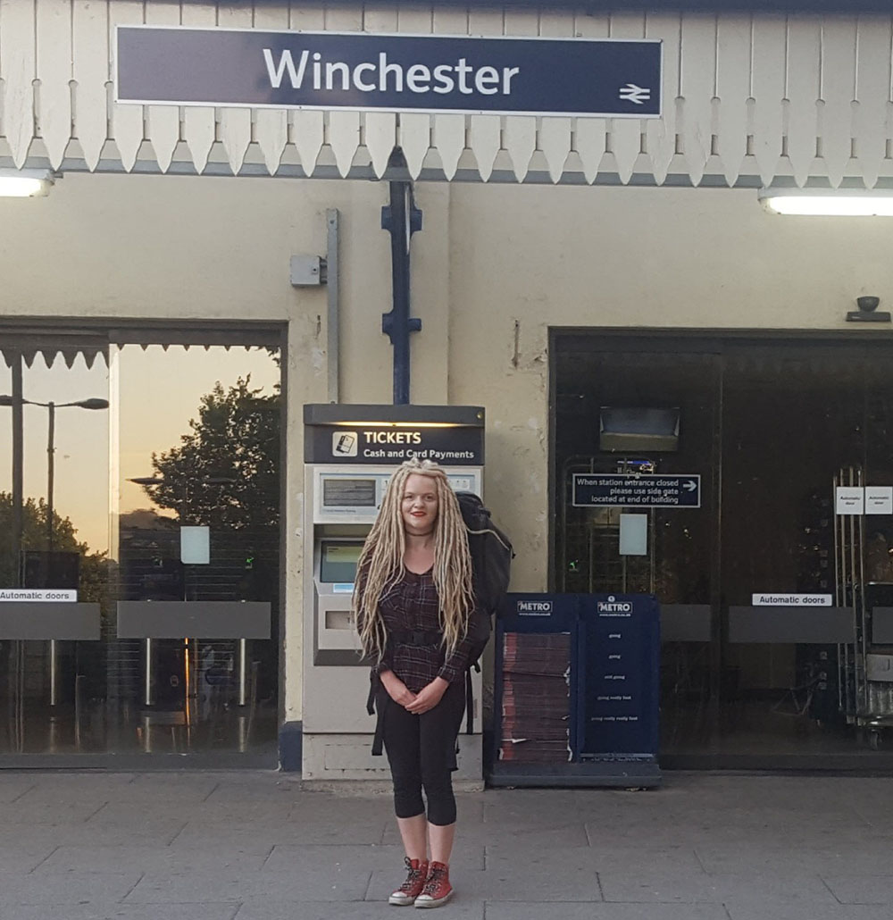 Student Sarah Buck stood with packed bag outside Winchester train station