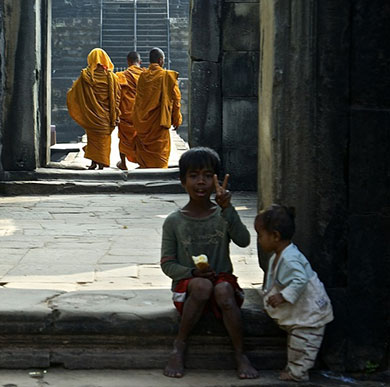 Centre for Religion, Reconciliation and Peace image of Asian monks and small boy making V-sign