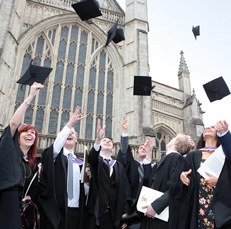 Student graduating outside Winchester Cathedral