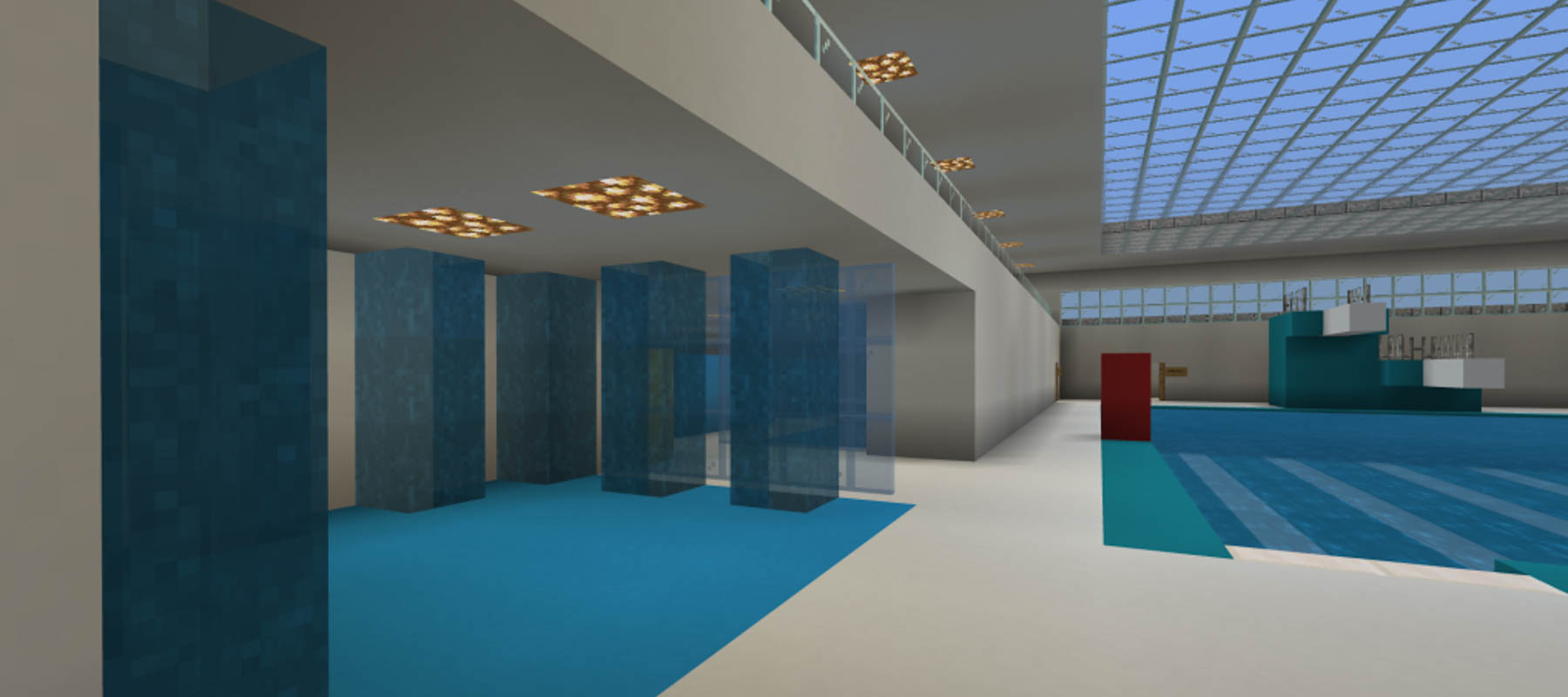 Mock up of lower level indoor swimming pool, with swimming pool, diving boards and changing areas
