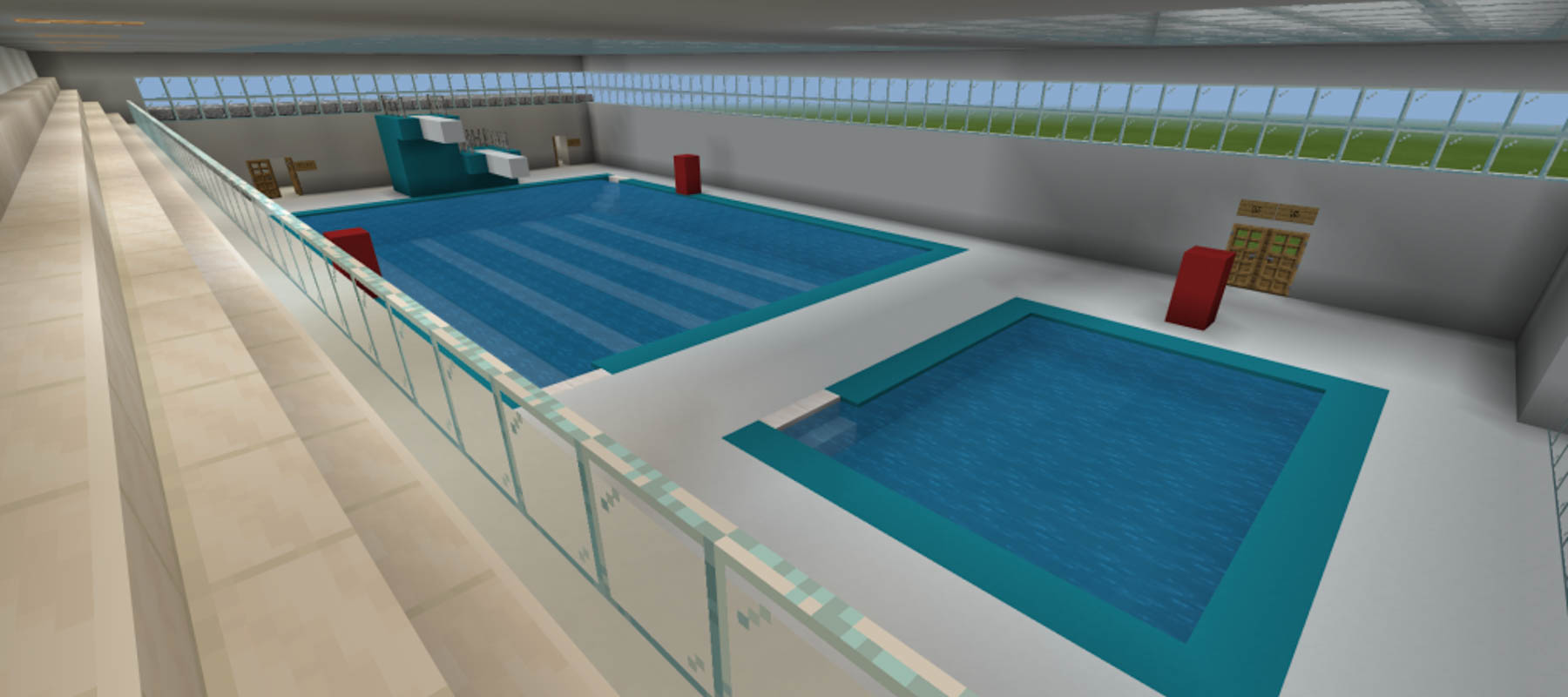 Mock up of indoor swimming pool, with two pools, two diving boards and a seating area