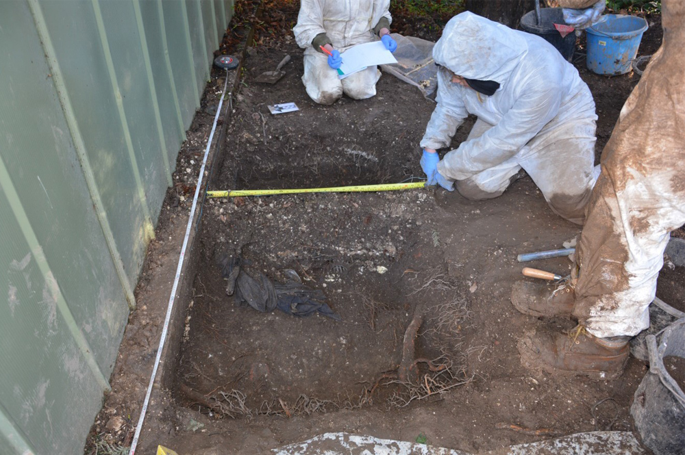 students digging as part of forensics course